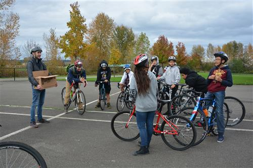 Bike Leaders gather students in a circle for an ice breaker