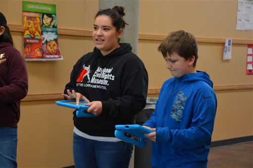 Teacher Kayla Guyett and students learn about coding