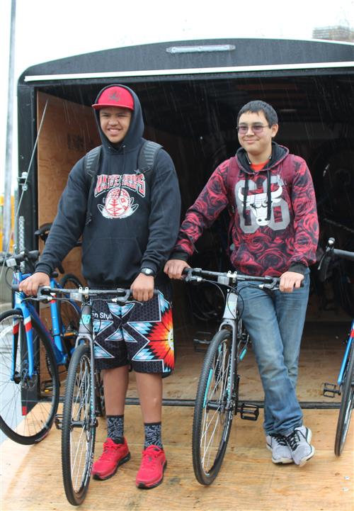 In the pouring rain, students receive new bikes from the Major Taylor Project